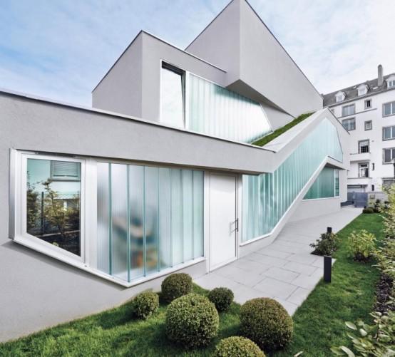 Modern Home Made Of Three Irregularly Shaped Volumes