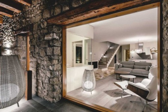 Modern Home With Stone Walls And Wooden Beams