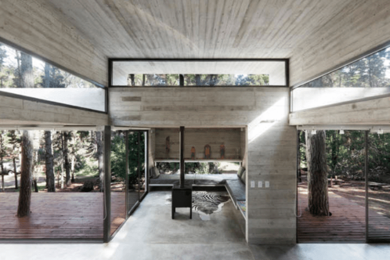 Modern holiday house of concrete opened to nature digsdigs for Modern house holiday lets