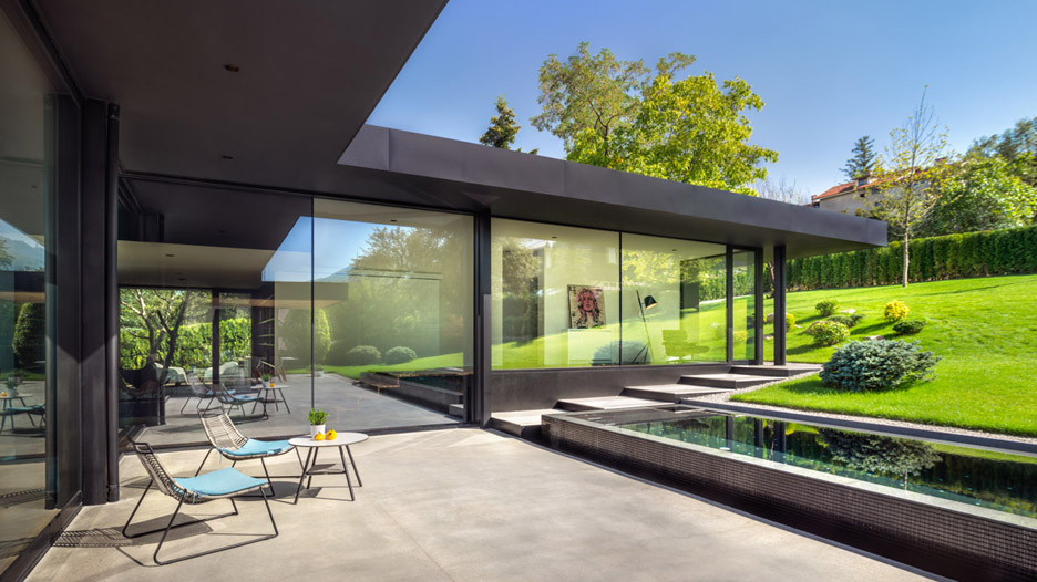 Picture Of modern house with a retro car as a focal point  7