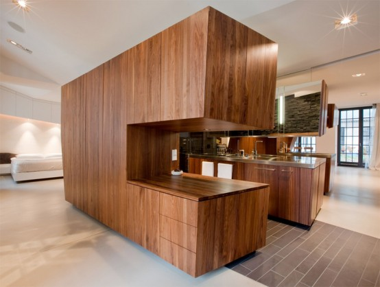 http://www.digsdigs.com/photos/modern-loft-with-a-freestanding-centralized-wood-veneer-kitchen-2-554x418.jpg