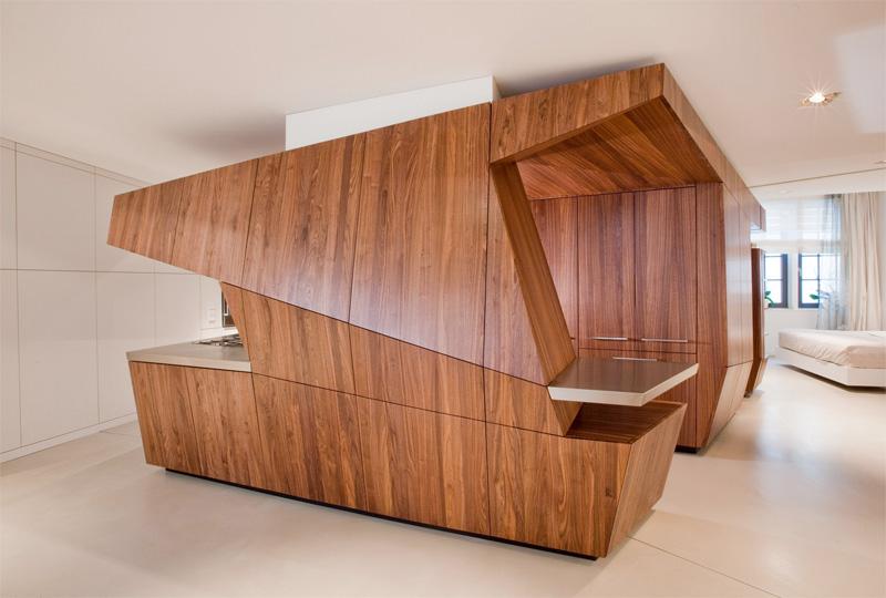 Modern Loft With A Freestanding Centralized Wood Veneer