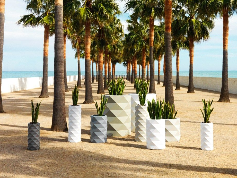 white, grey and ivory faceted planters of various sizes will create a bold and chic decor combo for your outdoor space