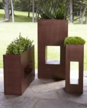 rectangular copper planters with cavities at various heights look modern, stylish and very statement-like