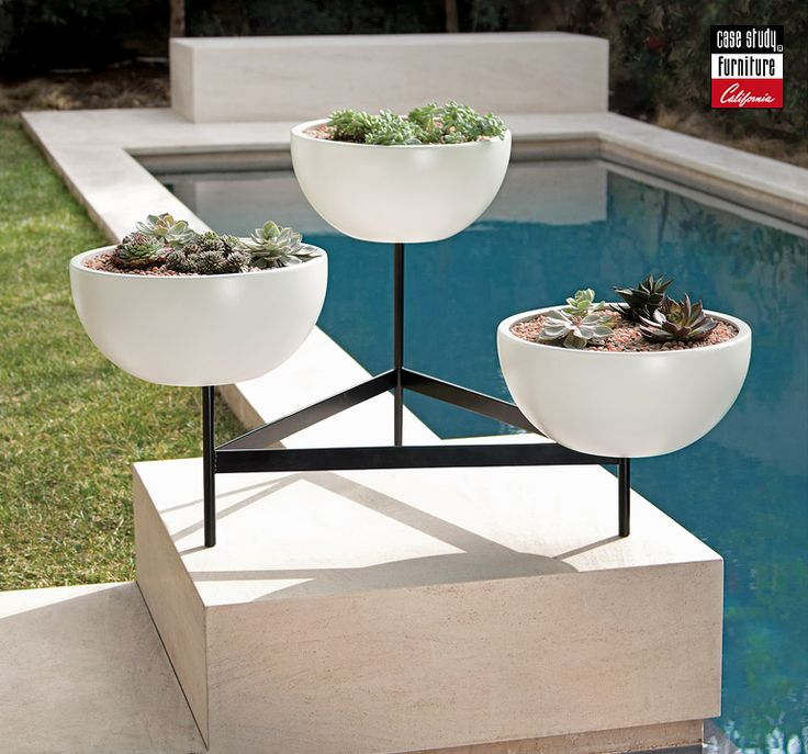 three white bowl planters on a stand will highlight any outdoor space and will make it look cool