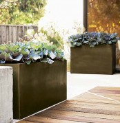 black porcelain planters will give an edgy feel to your outdoors and will make a statement with their color