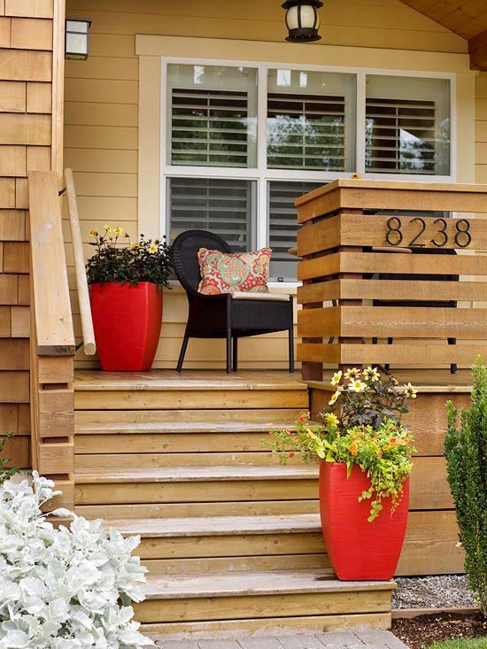 tall red planters with greenery and blooms will accent your space with a touch of color and will make it bright and fun