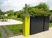 tall square black and neon yellow plants like these ones are sure to display your plants at their best and can separate the spaces
