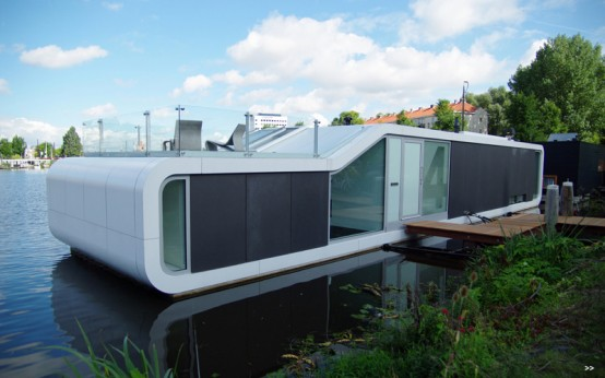 Modern Houseboat In The Amstel River of Amsterdam
