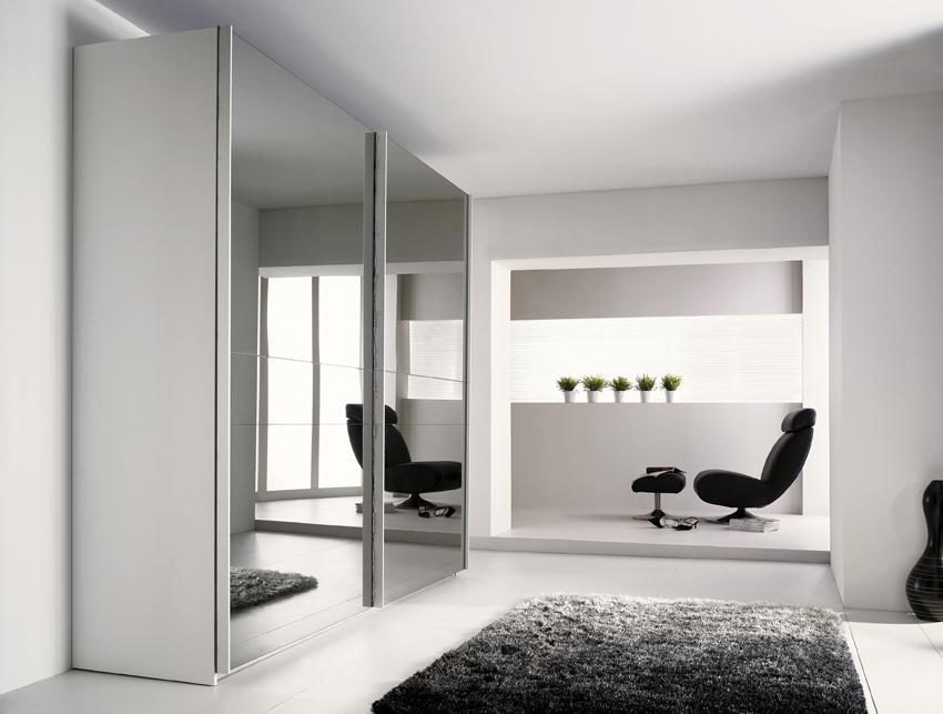 Modern wardrobe with refined door design stuart from for Modern wardrobe interior designs