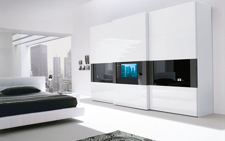 Super modern bedroom wardrobe with a tv built in the door for Bedroom built in wardrobe designs