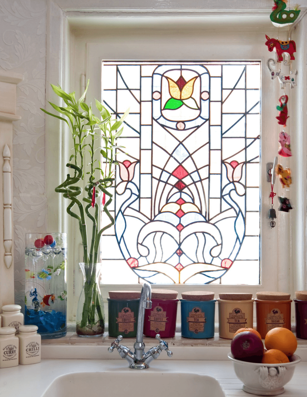 colorful stained glass window is private and bold, it keeps privacy giving a slight vintage feel to the space