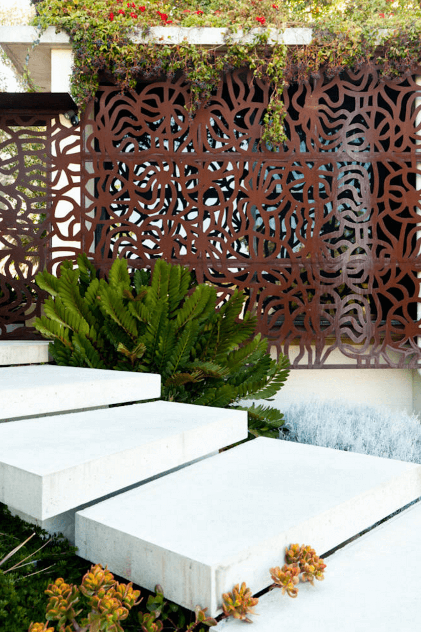 patterned iron screens will make your space private and stylish and will add pattern to outdoors and indoors