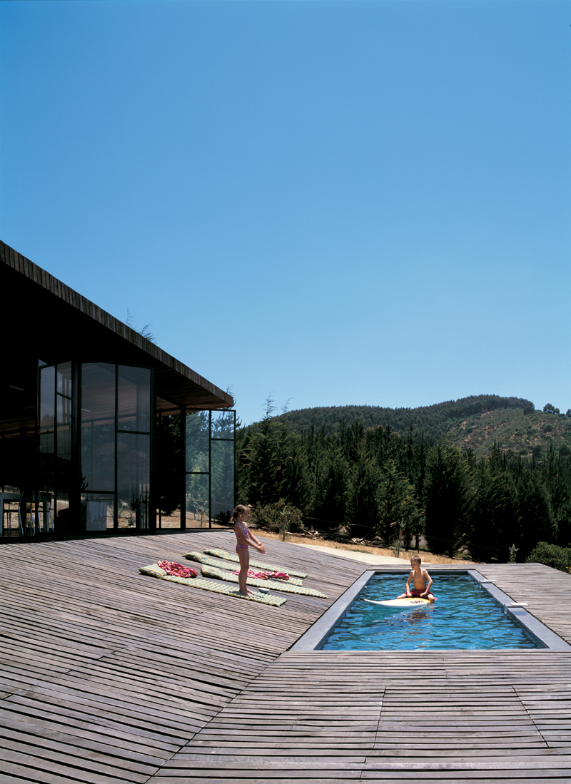 Modern wooden house designed around a deck digsdigs for Wooden pool