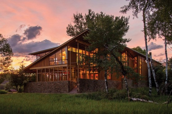 Montana Glass Home With Lots Of Natural Wood In Decor