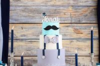 moustache-themed dessert table for a boy baby shower