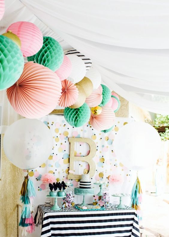 multicolor dessert table for a modern baby shower