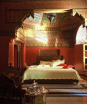 a unique bright patterned alcove is a perfect base for a Moroccan bedroom, carved wooden furniture and lanterns add to the space