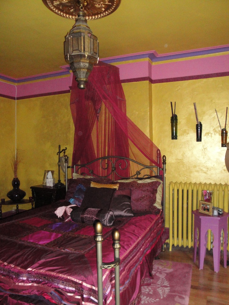 gold, pink, hot red and burgundy and Moroccan lanterns create a genuine Eastern sleeping space