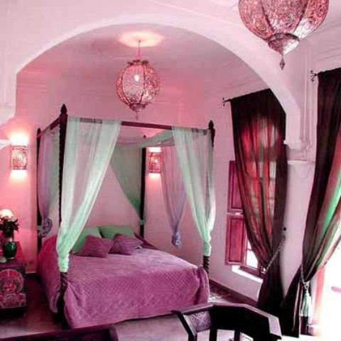 this Moroccan bedroom is given a girlish feel with shades of pink and fuchsia, with bright curtains and a canopy