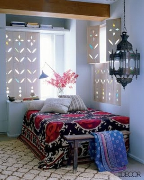 carved wooden shutters, a Moroccan lantern and bright printed textiles create a bold Moroccan look