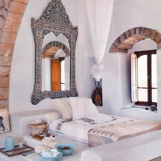 a statement ornate mirror and bedding inspried by Moroccan wedidng blankets look very chic and catchy