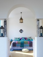 a Moroccan lantern, bright textiles and Moroccan pillows and cushions for a modern take on traditional Eastern bedrooms