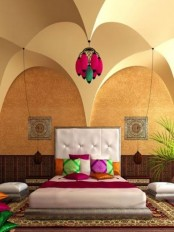 colorful pillows, rugs and artworks plus arched volumes create a proper Moroccan ambience