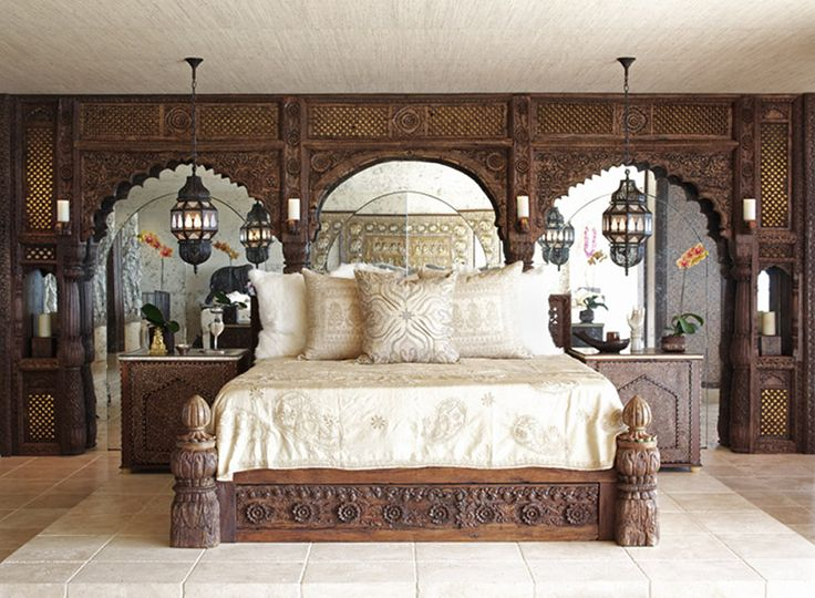 carved wooden panels, a bed and nightstands and Moroccan lanterns for a neutral Eastern room