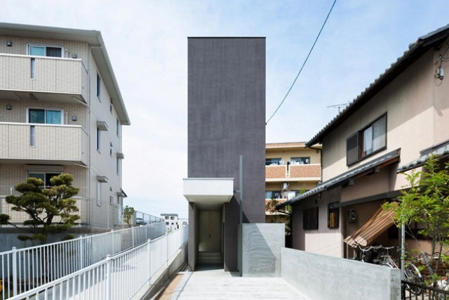 Narrow Urban Home With Industrial Minimalist Interiors