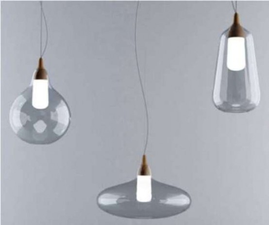 A Stylish Collection Of Lamps And Vases Made Of Glass And Cork