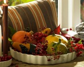 a white porcelain bowl with berries and veggies is an easy and a super natural Thanksgiving or fall centerpiece to rock