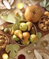 pumpkins, nuts, pears and apples plus leaves are great to make up a soft-colored Thanksgiving tablescape