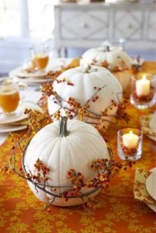 white pumpkins wrapped with berry branches are gorgeous for a Thanksgiving tablescape, an easy centerpiece to rock