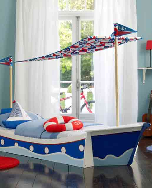 nautical inspired boys bedroom for two with a cool wooden ship hanged