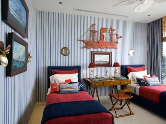 Nautical-inspired boys bedroom for two with a cool wooden ship hanged on a wall.