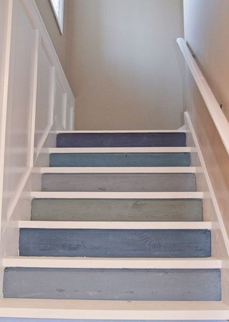 a nautical staircase with backing of steps done in various shades of blue and grey is a lovely and pretty idea