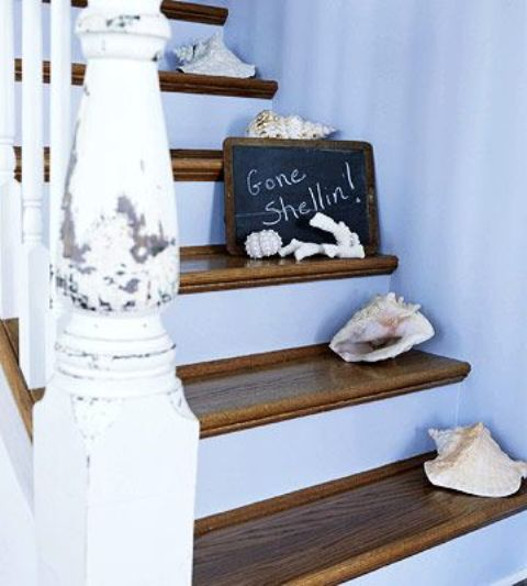 a shabby chic beach staircase with stained steps, seashells and a chalkboard sign plus shabbychic railing
