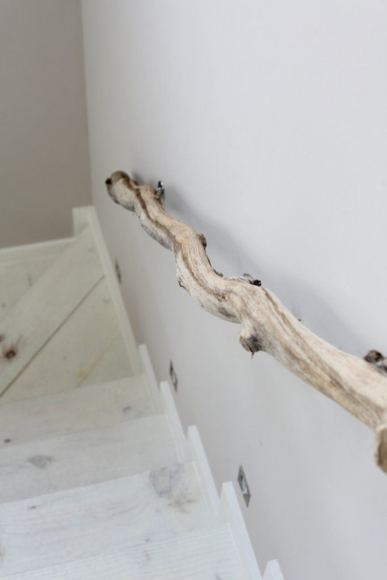 a whitewashed staircase with driftwood railings is a fresh and non-typical idea of a beach staircase