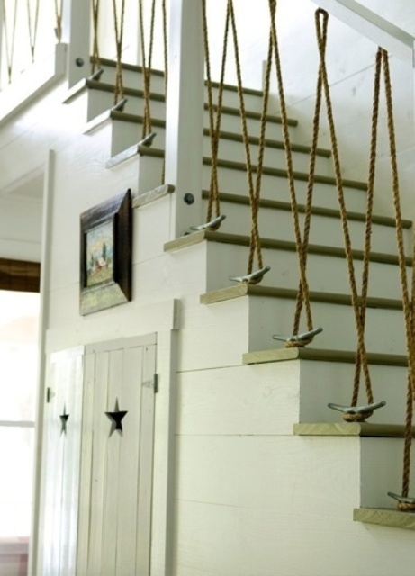 a nautical staircase with railing with rope and driftwood looks very whimsical and bold