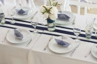 navy-inspired table setting  for a boy baby shower