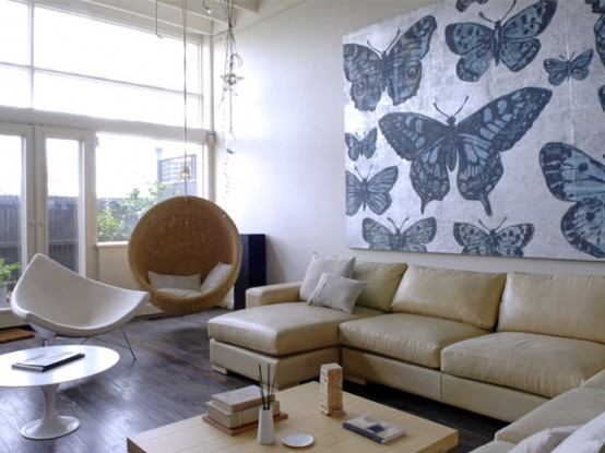 Neutral Room With Interesting Chairs And Artworks That Create Drama