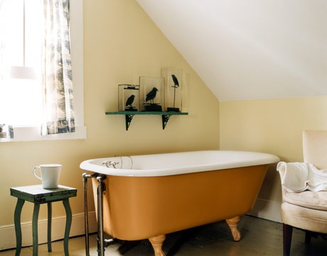 a rust-colored bathtub will accent your neutral space and add color to it, which means adding interest to the space, too