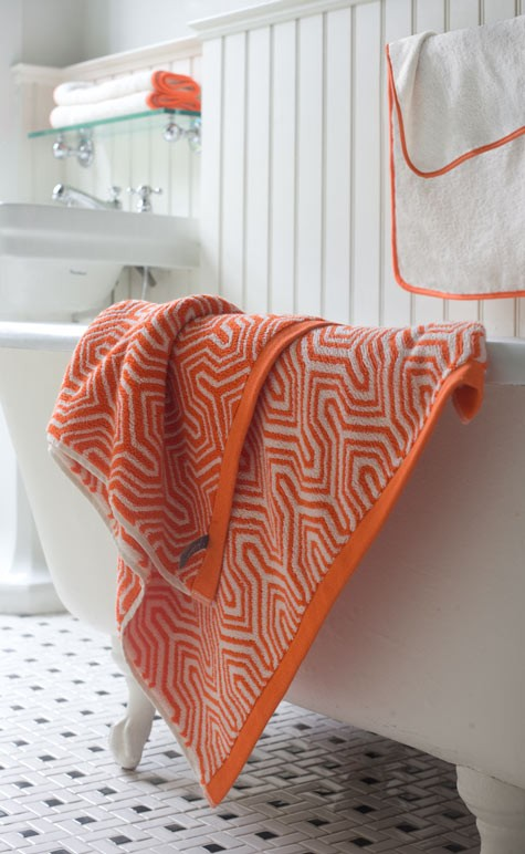 add bright orange touches to your neutral bathroom easily and without fuss with textiles - curtains, rugs and towels