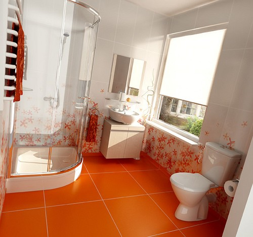 an orange floor with large scale tiles and white and orange flower tiles plus orange towels for a bright modern bathroom