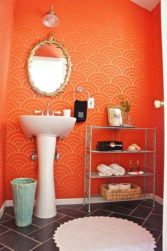 brighten up your bathroom with orange printed wallpaper - wallpaper in bathrooms is a very hot trend