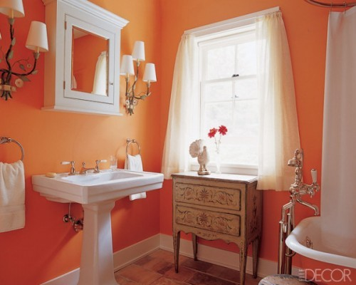a romantic orange and white bathroom in vintage style looks fresh, vivacious, warm and very inviting