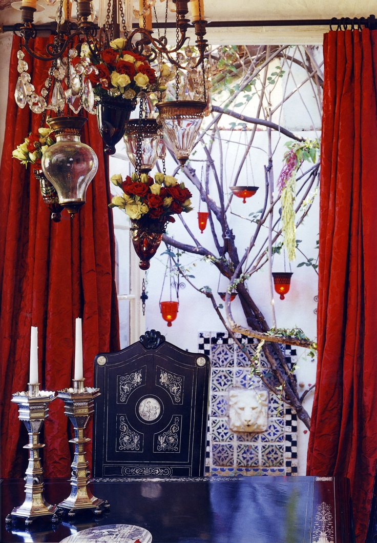 a bright dining space done with red and blues, Moroccan touches and candles
