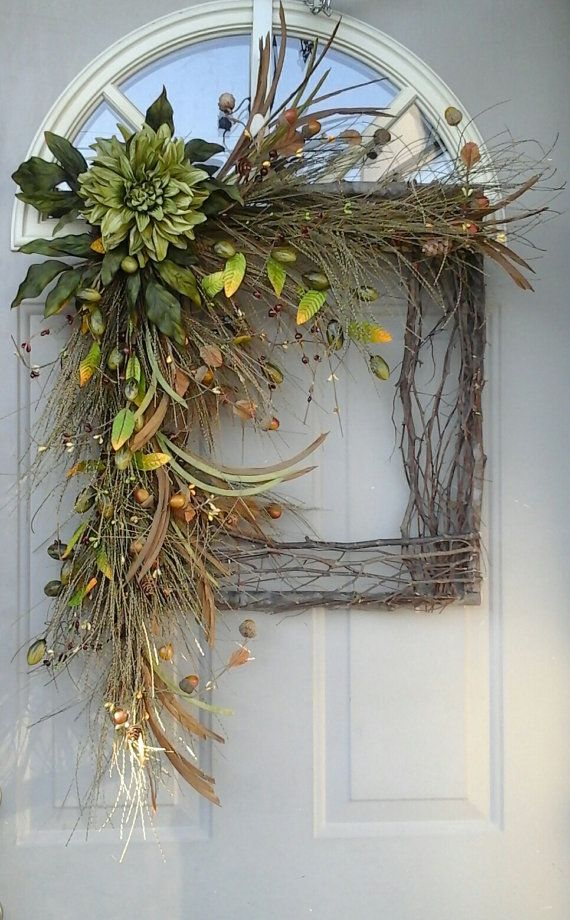 a square vine and twig wreath with greenery, foliage, faux blooms, berries and fruit for the fall