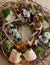 a very textural twig fall wreath with antlers, moss, dried blooms, burlap and a burlap bow will bring a woodland feel to your space